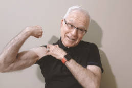 Our client, Harvey Asher flexing