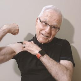 Our client, Harvey Asher flexing